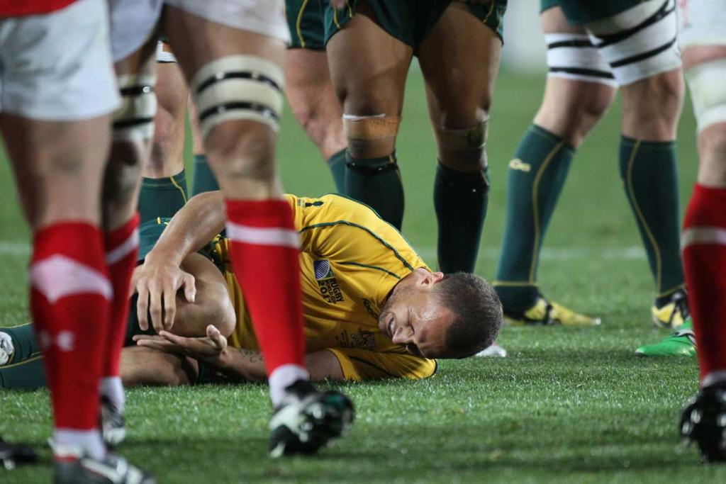Australia first-five Quade Cooper on the ground after a knee injury.