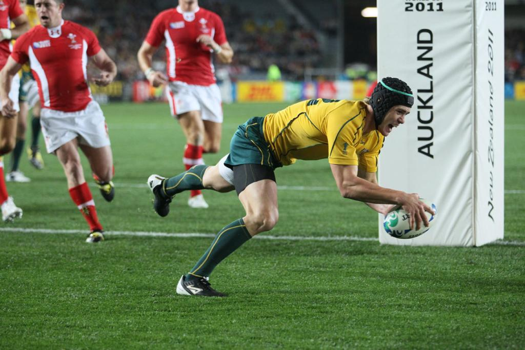 Australia second-five Berrick Barnes races in to score the opening try.