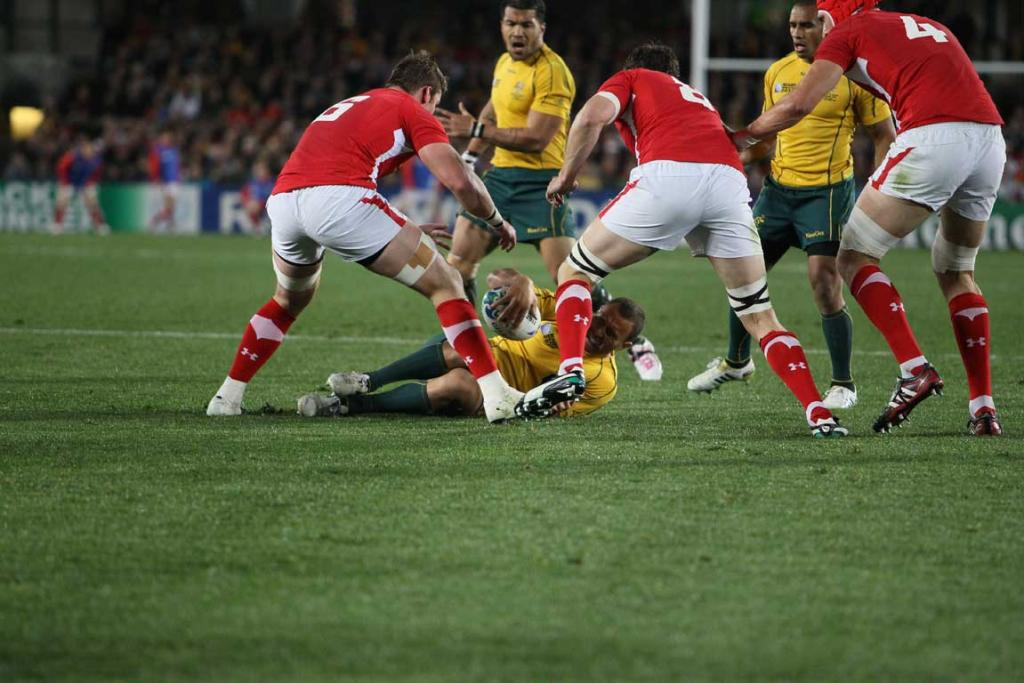 Australia first-five Quade Cooper goes down hard with a knee injury.