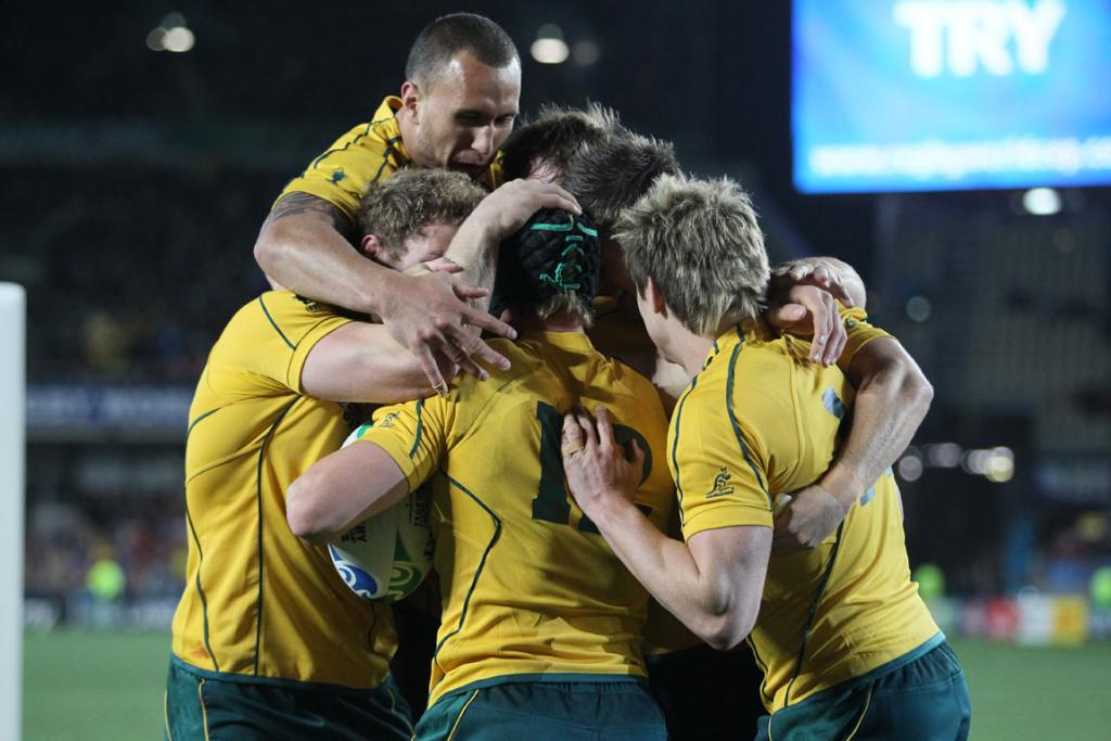 Australia second-five Berrick Barnes and teammates celebrate his try.