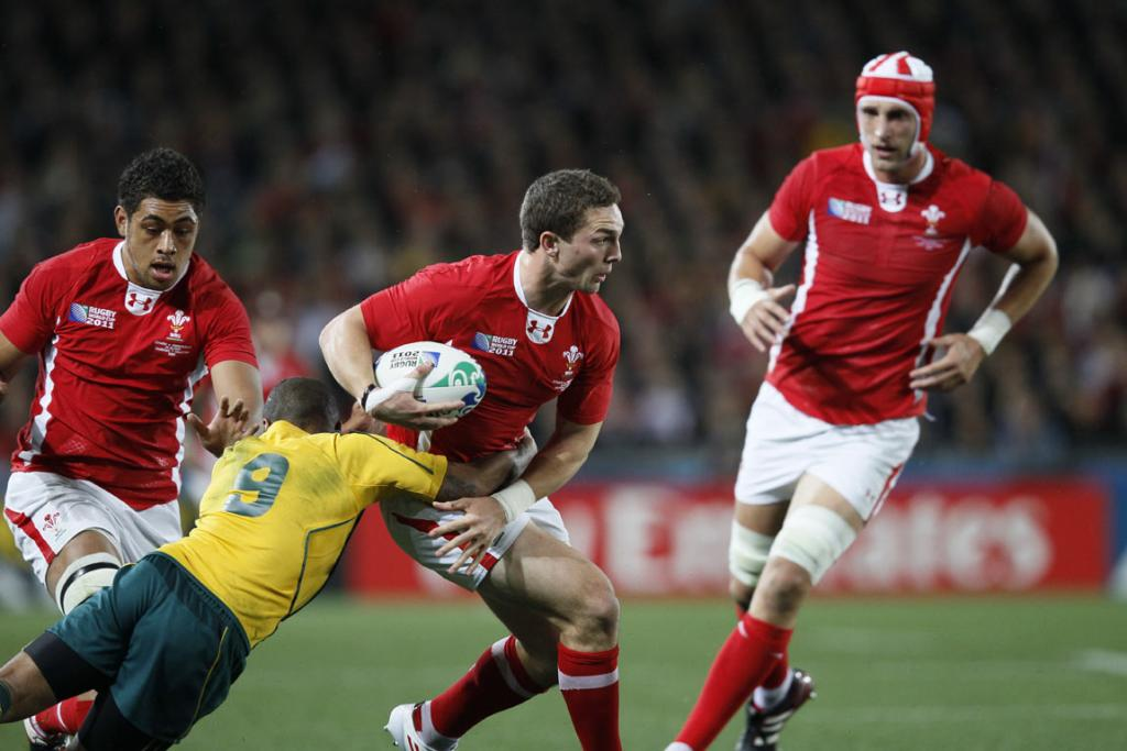 Wales right wing George North runs the ball upfield.