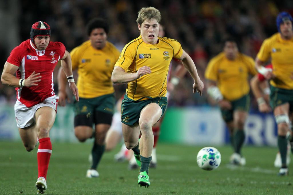 James O'Connor of Australia chases down the ball.