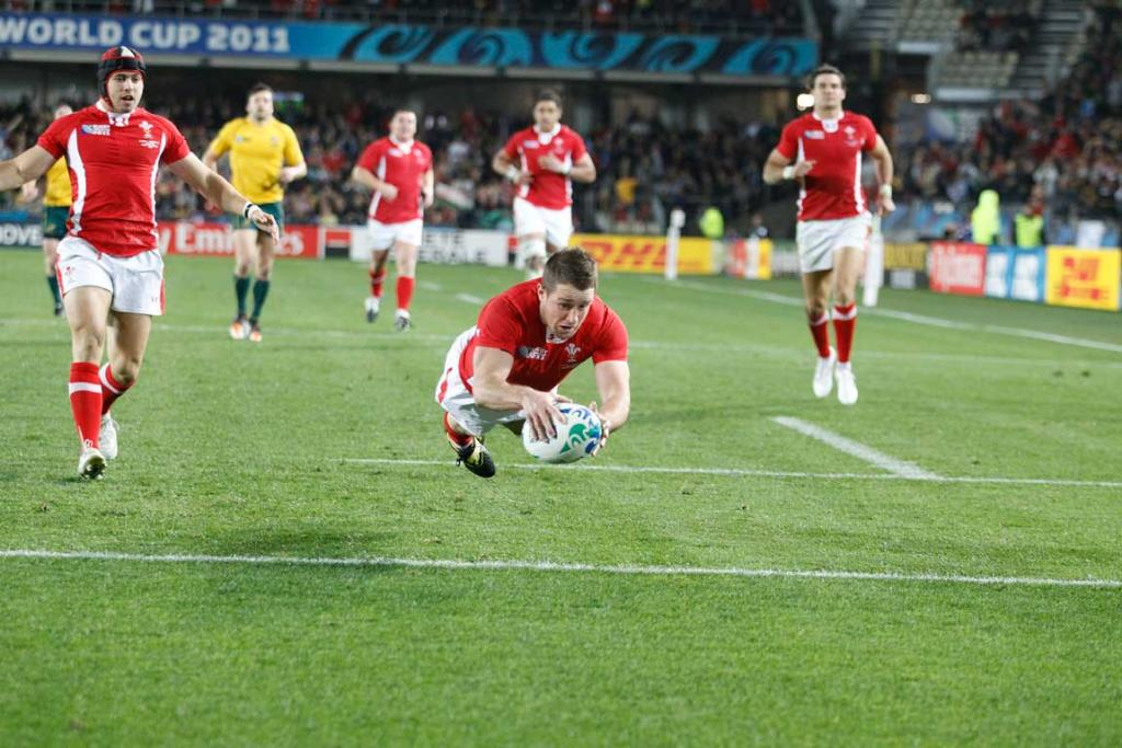 Wales left wing Shane Williams scores a try.