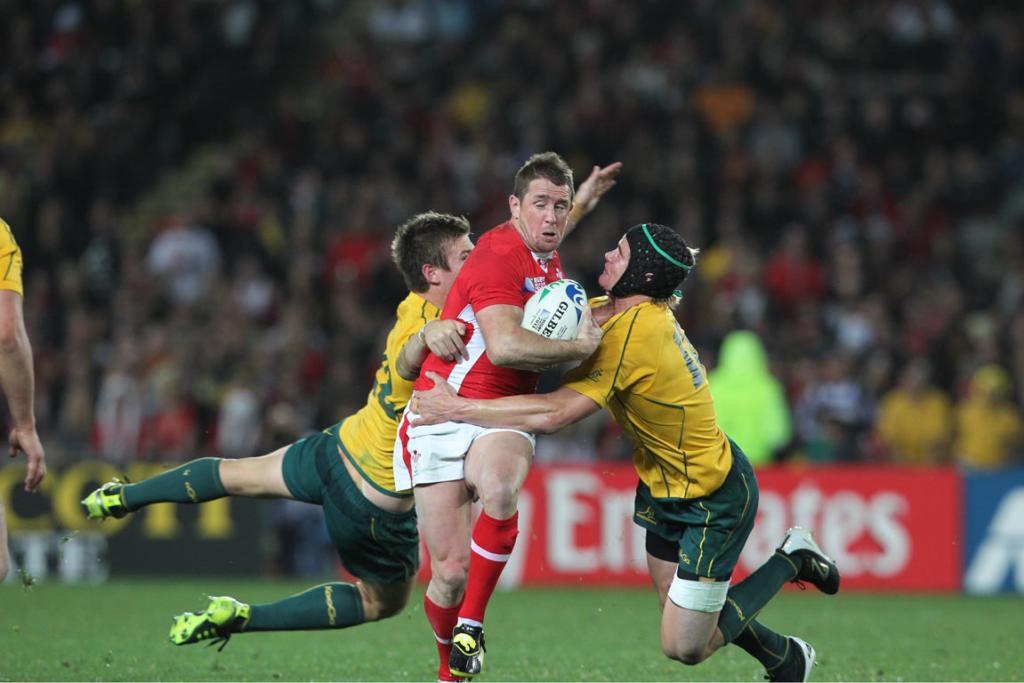 Wales left wing Shane Williams is taken out by Australia's defence.