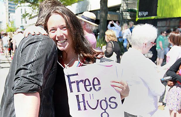 CUDDLY: Jo Fairclough is offering free hugs to passersby.