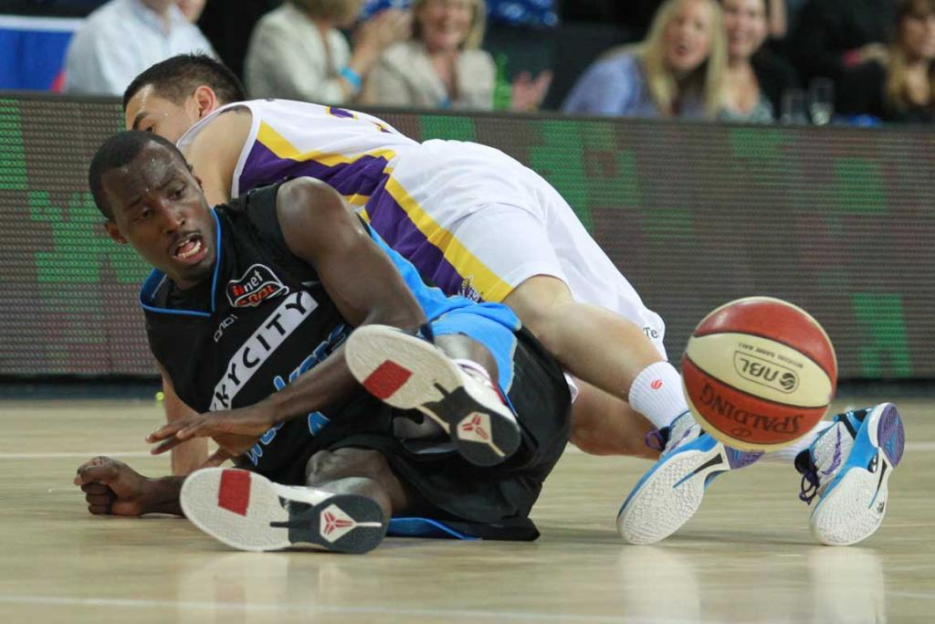 Breakers guard Cedric Jackson tangles with Sydney's Luke Martin going for a loose ball.