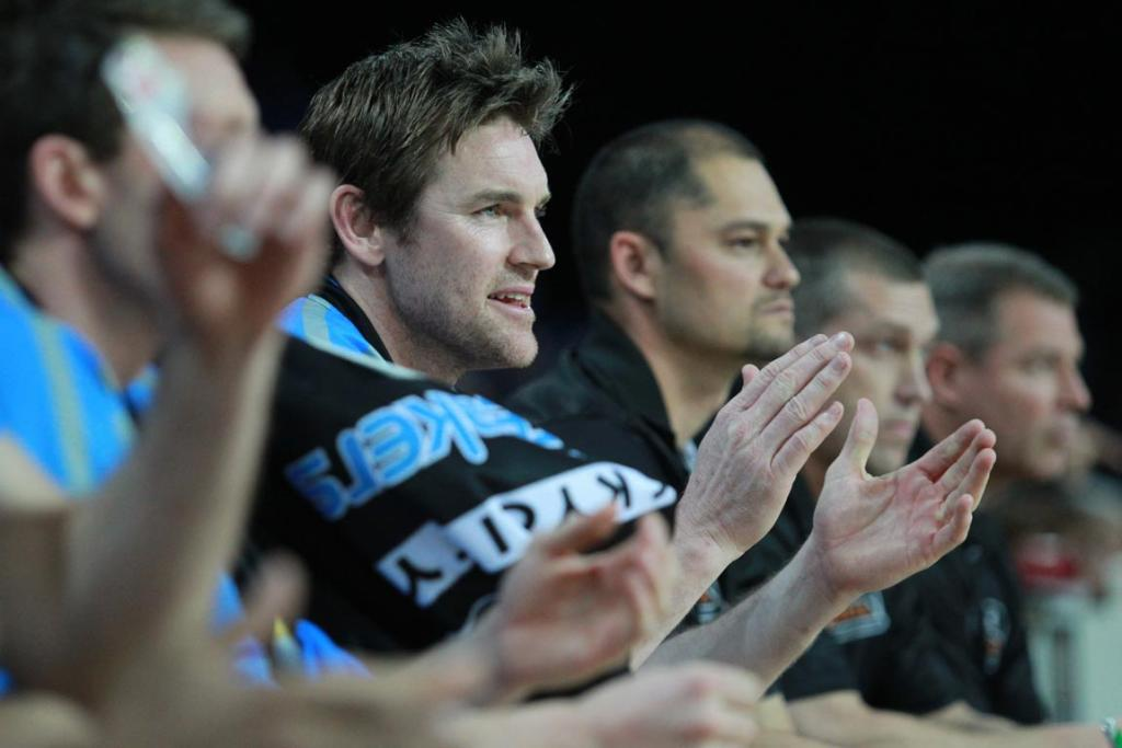 Breakers forward Dillon Boucher applauds from the bench.