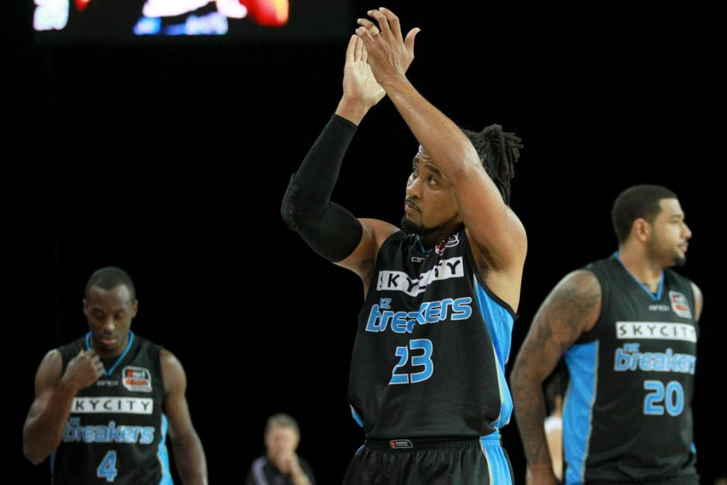 Guard CJ Bruton waves to the Vector Arena crowd as the Breakers leave the court after warm-ups.