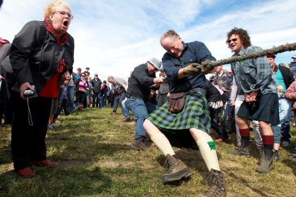 The Red Team, made up from people who put their names down won the tug-o-war final. Team member Stewart Hyder wore his kilt in keeping with the theme while supporter, Victoria Johson-Craig, left, added her voice to the winning effort.
