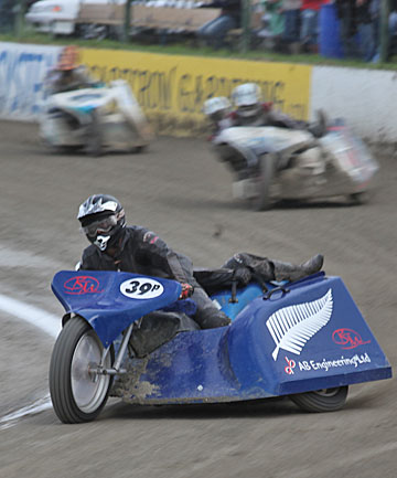 DICING WITH DIRT: Swinger Philippa Burns hanging on for dear life as husband Andrew Buchanan steers their sidecar around a track.