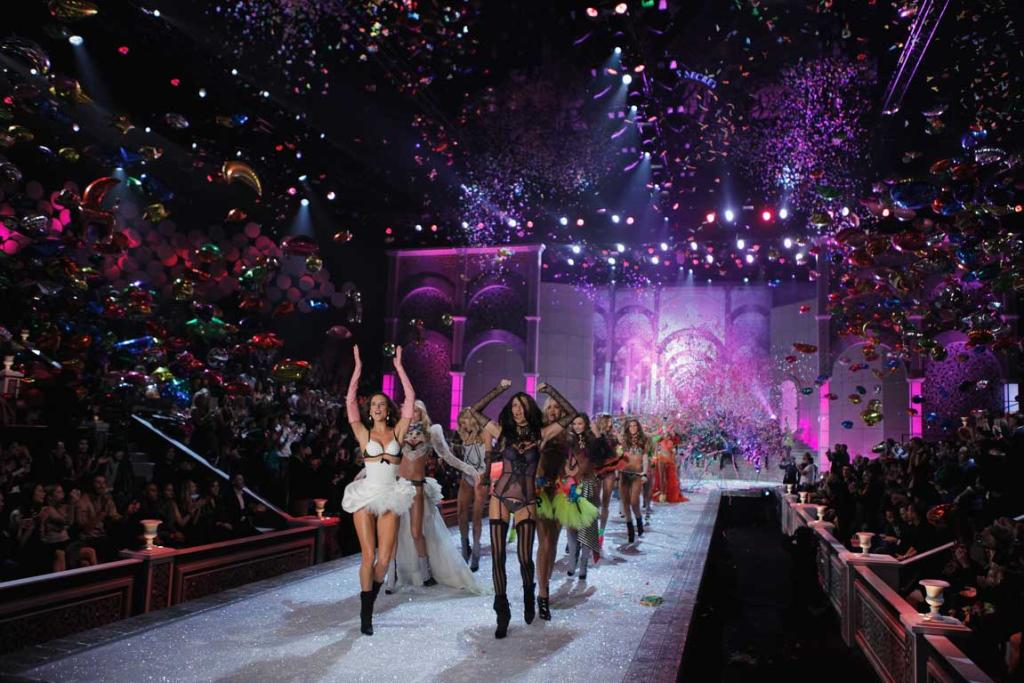 Victoria's Secret models celebrate during the finale of the Victoria's Secret Fashion Show at the Lexington Armory in New York.