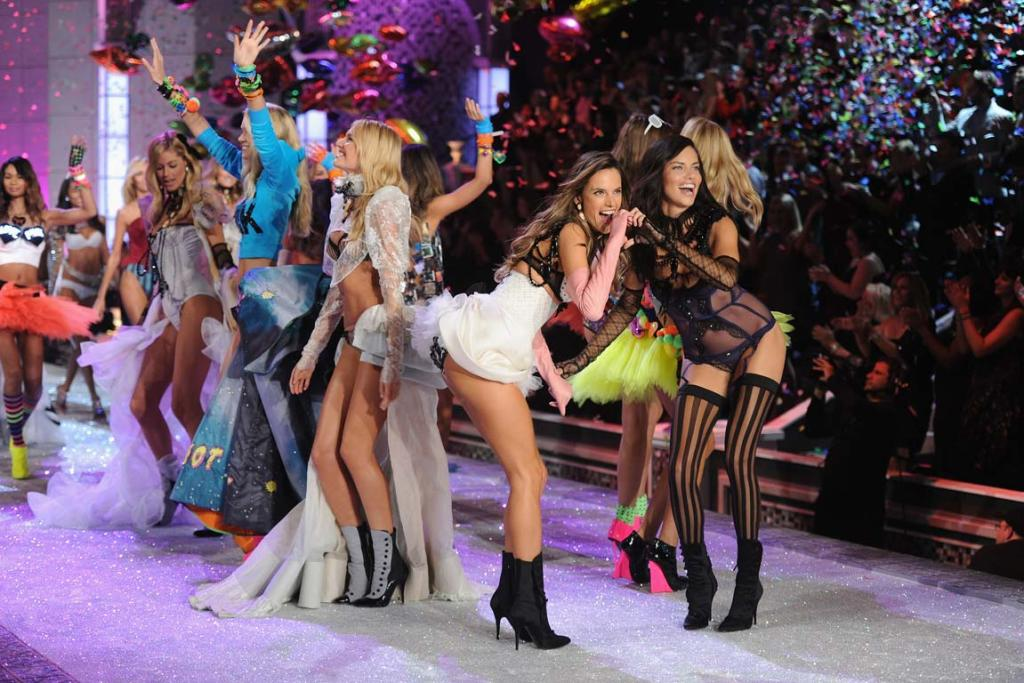 Alessandra Ambrosio, left, and Adriana Lima pose on the runway during the 2011 Victoria's Secret Fashion Show.
