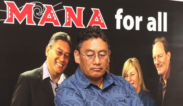 PEOPLE POWER: Mana Party leader Hone Harawira in front of a poster featuring himself, Sue Bradford and John Minto.