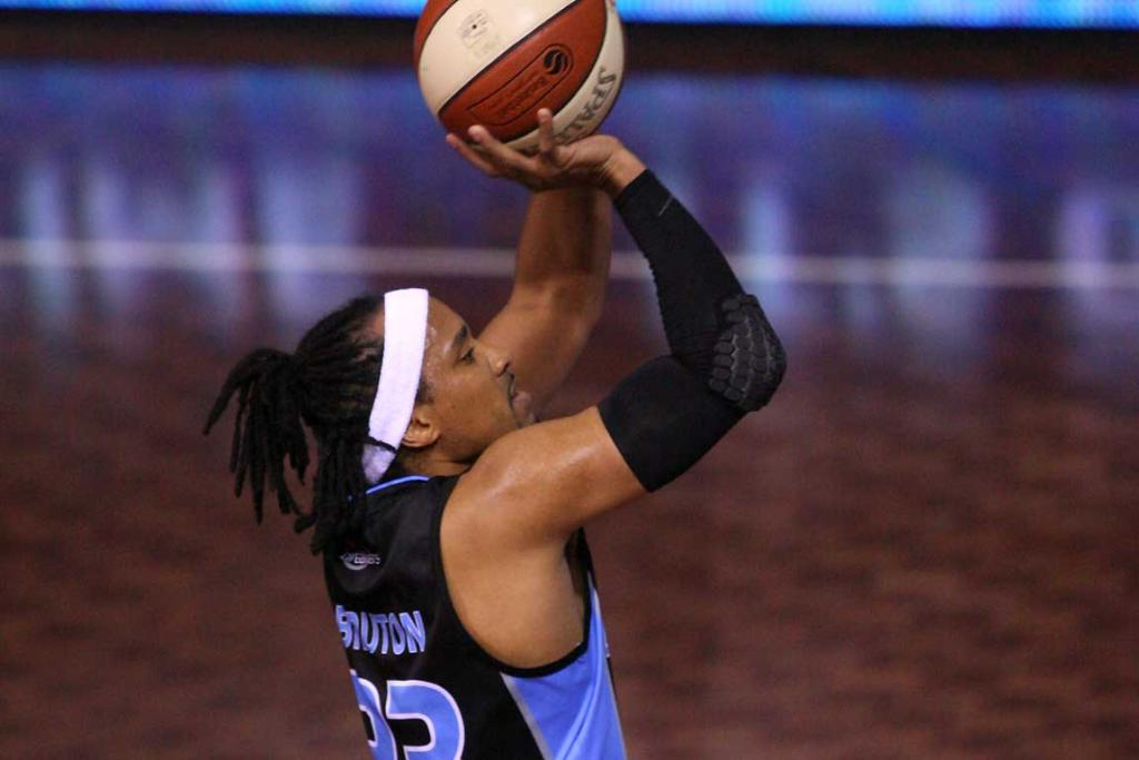 Breakers guard CJ Bruton shoots a three pointer against the Wollongong Hawks at North Shore Events Centre.