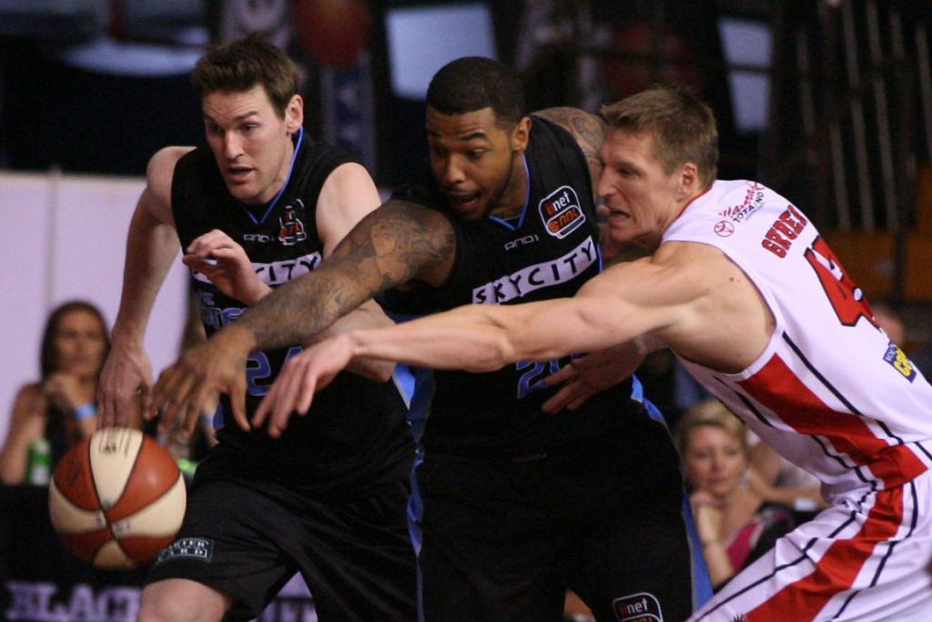 Breakers forward BJ Anthony and Hawks forward Dave Gruber scramble for the ball.
