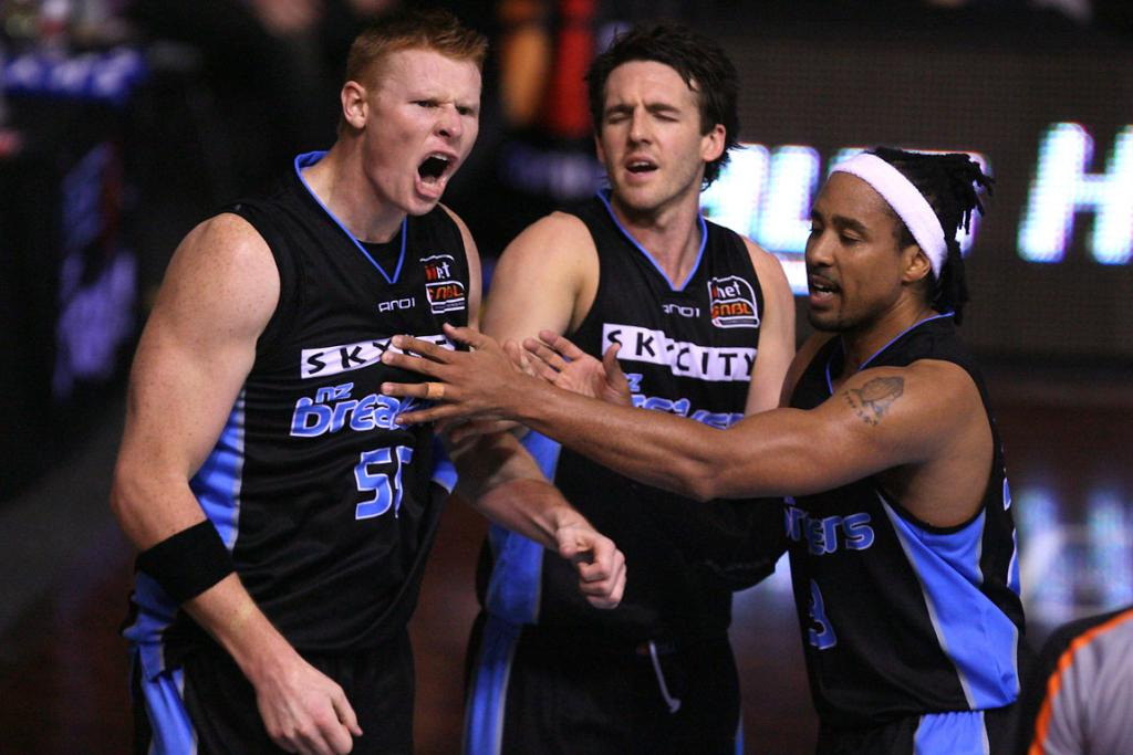 Breakers Forward Gary Wilkinson fires up after colliding with Hawks player Glen Saville on the way to the hoop.