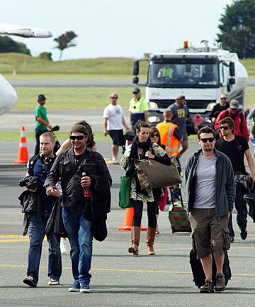 Cast and crew arrive yesterday at Nelson Airport aboard  a chartered jet  on their way to the Takaka Hill to film part of the Hobbit.