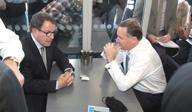 BANK ON IT: Prime Minister John Key with ACT's Epsom candidate John Banks at an Auckland cafe, with the pouch containing the alleged recording device on the table.