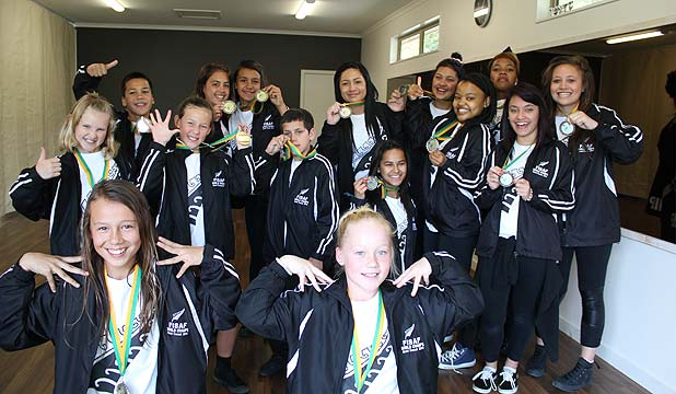 HIP-HIP-HURRAY: Gold medal winners, front: Maddison Rogers, Brodie Record. Back from left: Kelly Mcintosh, Reon Lewis, Jhorjah McEwen, Emma Manihera, Jasmine Ngaropo and Darian Lewis from Future Crew and silver medal winners Chikhayla Broughton, Jennifer Ihaka, Cori-Leigh Wood, Dineo Mpe, Leshego Mpe, Summer Ruwhiu and Jordyn Pitman from Kani Krew celebrate their success at the World Hip Hop Championships.