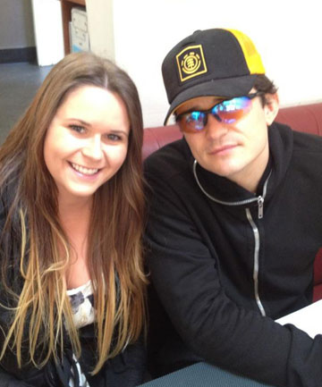 TALENT SPOTTER: Fan Alexandra Hopkirk and Hobbit star Orlando Bloom at a Queenstown cafe yesterday morning.