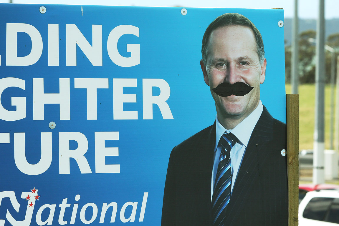 A billboard of National's John Key is the victim of arty politics.