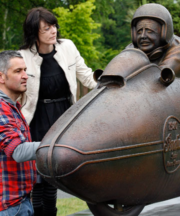 SPEED MERCHANT: Geoff Van Dam and Megan Beck check out the new Burt Munro sculpture unveiled on Saturday at the Gala St reserve.