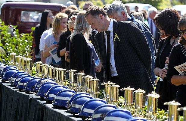 ONE YEAR ON: Prime Minister John Key walks past the display of the helmets of the 29 men who still lie in the Pike River coalmine.