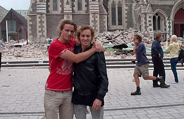 CLOSE: Brothers Andrew, left, and Mike Hewson outside the collapsed cathedral just after Andrew took pictures of it collapsing from Mike's studio.
