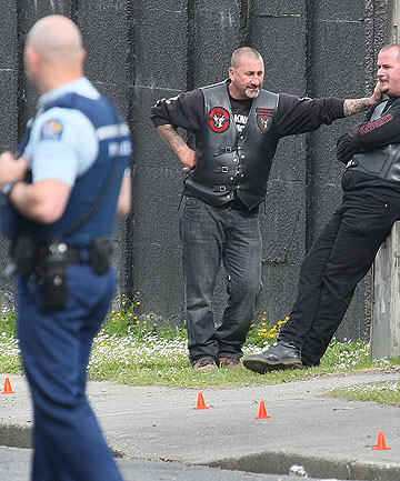 POLICE INVESTIGATE: Invercargill police and Road Knights gang members at the scene where a 32-year-old man was found unconscious.