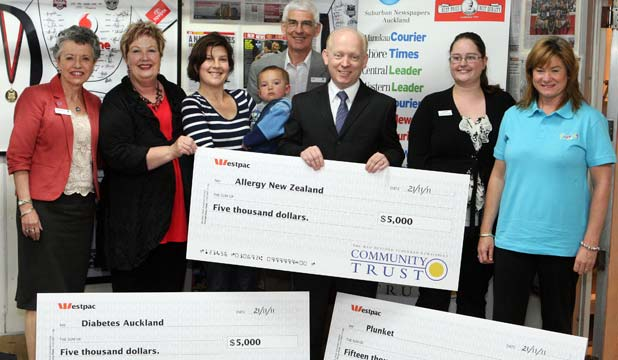 HANDOVER: Marguerite Durling of Diabetes Auckland, Penny Jorgensen, Rebecca Oliver and 20 month-old Dylan of Allergy New Zealand, John Denton of Diabetes Auckland, Suburban Newspapers general manager David Penny, Naomi Layzell and Gwenda Holster-Dowler, Plunket.