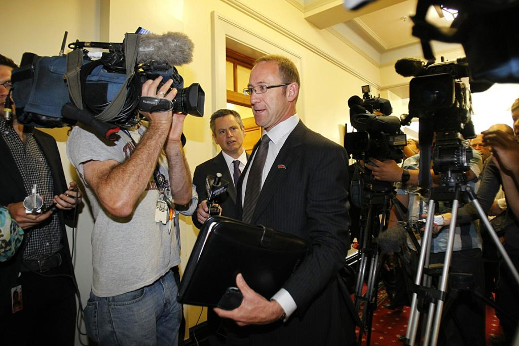 Andrew Little battles his way through the media scrum outside Labour's caucus meeting.