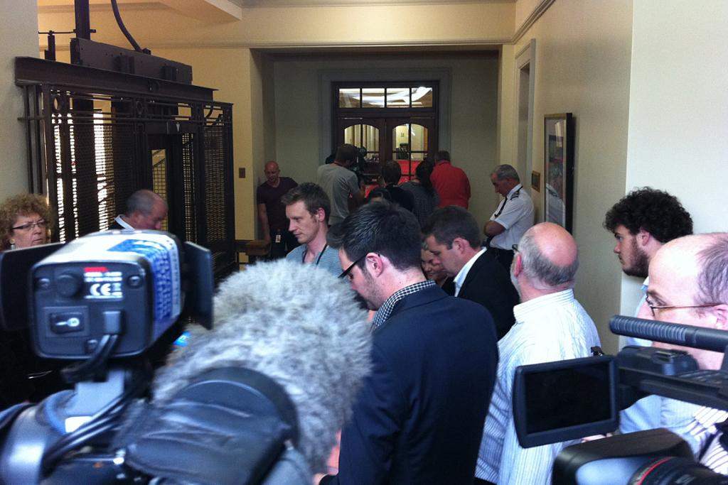 The media waiting for Phil Goff to speak after the meeting.