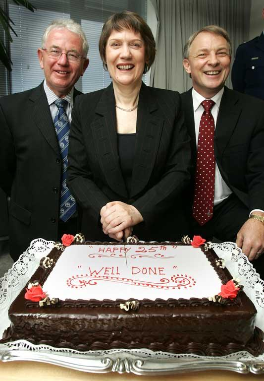Dr. Michael Cullen, then Prime Minister Helen Clark, and Phil Goff celebrate 25 years of parliament in 2006.