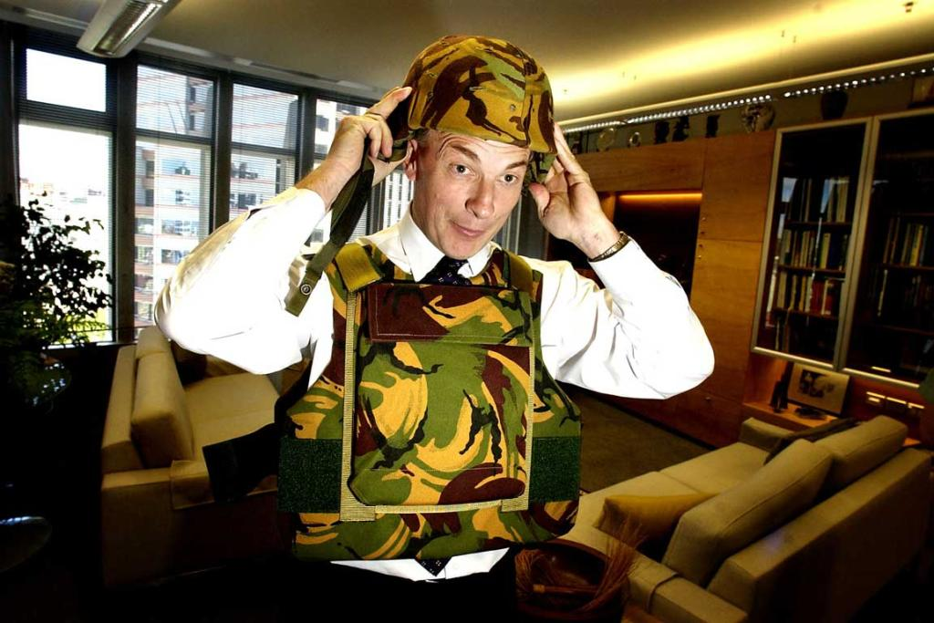 Phil Goff tries on a NZ Army flak jacket and helmet before his trip to Afghanistan in 2002.