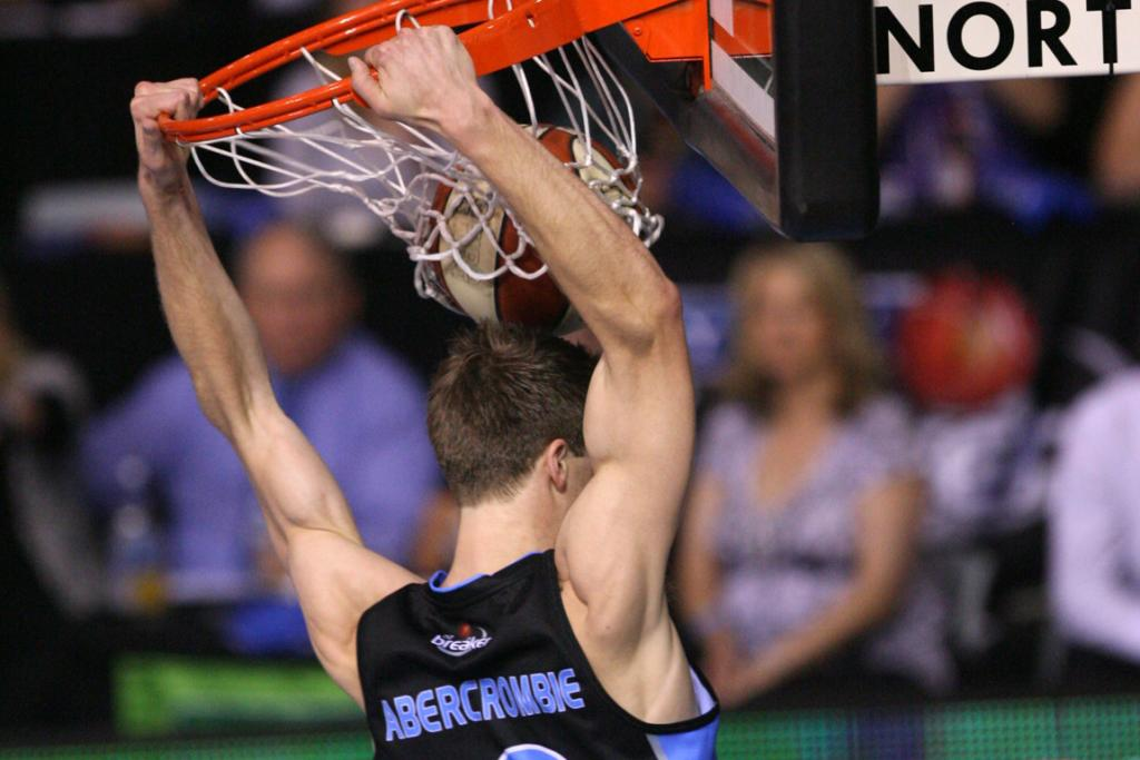 Breakers guard Thomas Abercrombie completes an impressive slam dunk against the Melbourne Tigers.