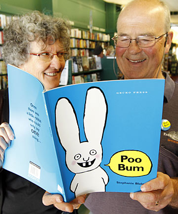 BIT OF A GIGGLE:  Susi Blackmore and Peter Rigg of Page & Blackmore Booksellers read Poo Bum.