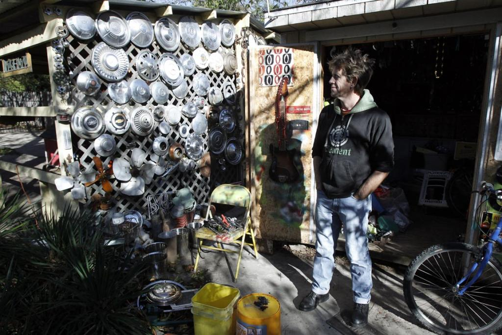 Jeff Ferrell, a professor of sociology at Texas Christian University, is pictured outside of his shop where he has organised thousands of useful but discarded items he has collected from dumpsters in Fort Worth, Texa.