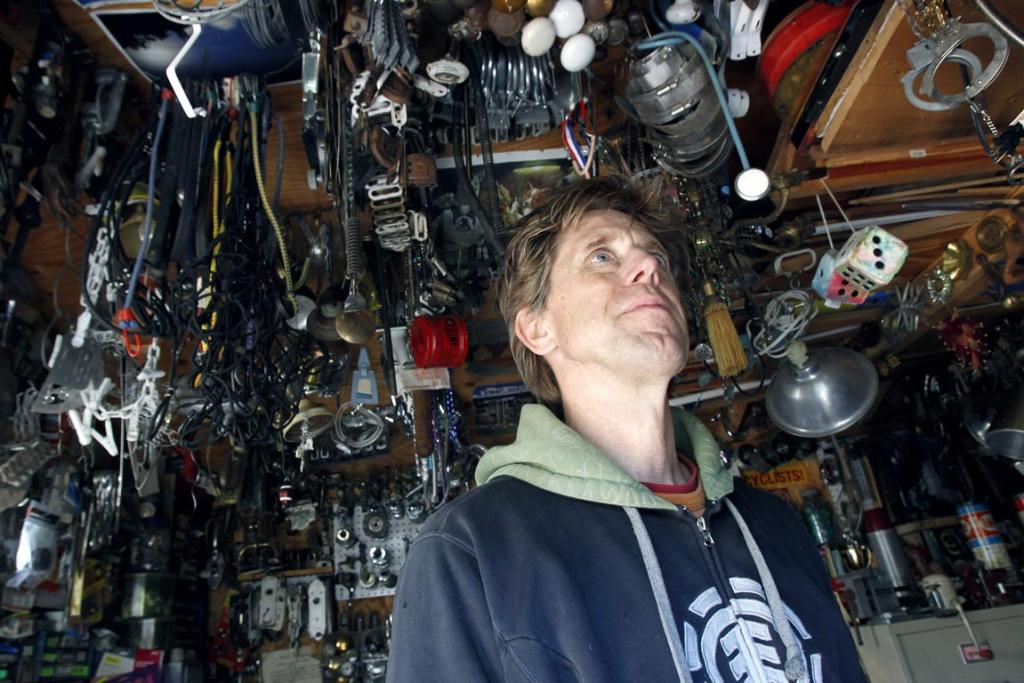 Jeff Ferrell, a professor of sociology at Texas Christian University, is pictured in his shop where he has organised thousands of useful but discarded items he has collected from dumpsters in Fort Worth, Texas. The TCU professor of sociology sifts through dumpsters and gives the vast majority of what he finds to the needy or to friends.