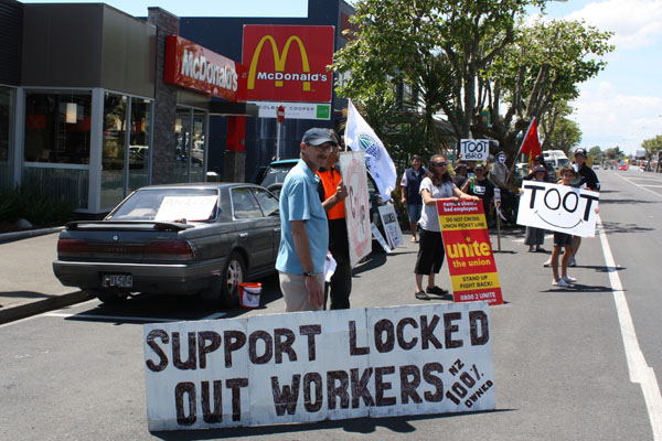 Wage protest: Freezing works staff protest over wage cuts outside Levin McDonald's.
