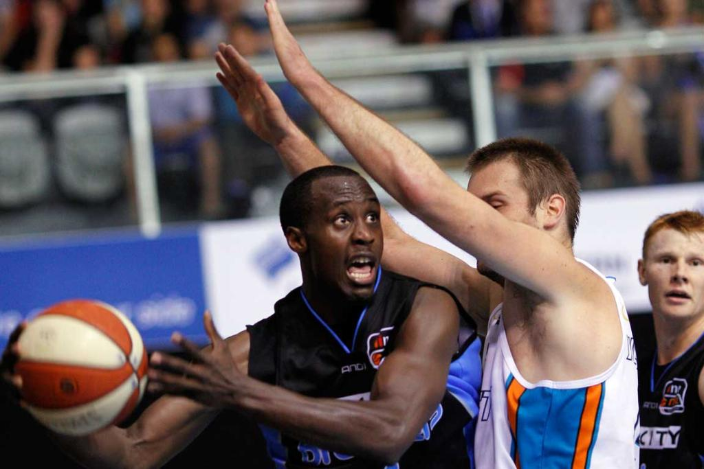 Breakers Cedric Jackson is marked by Blaze's Mark Worthington.