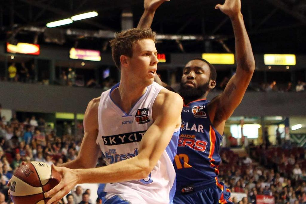 Tom Abercrombie of the Breakers under pressure from Chris Warren of the 36ers.