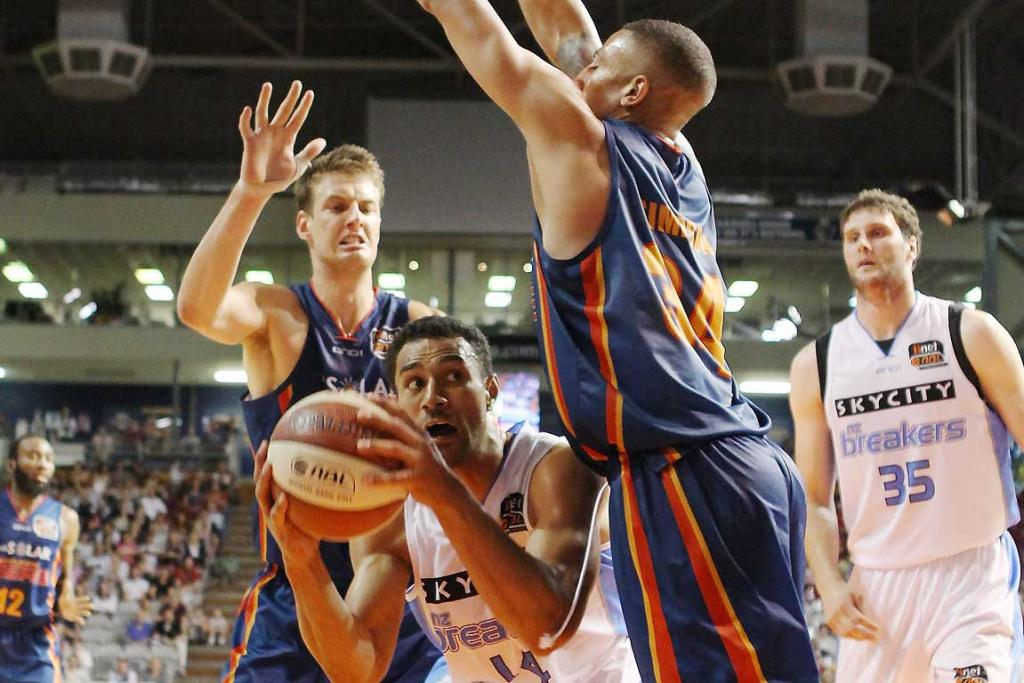 Mika Vukona of the Breakers competes with Diamon Simpson of the 36ers.