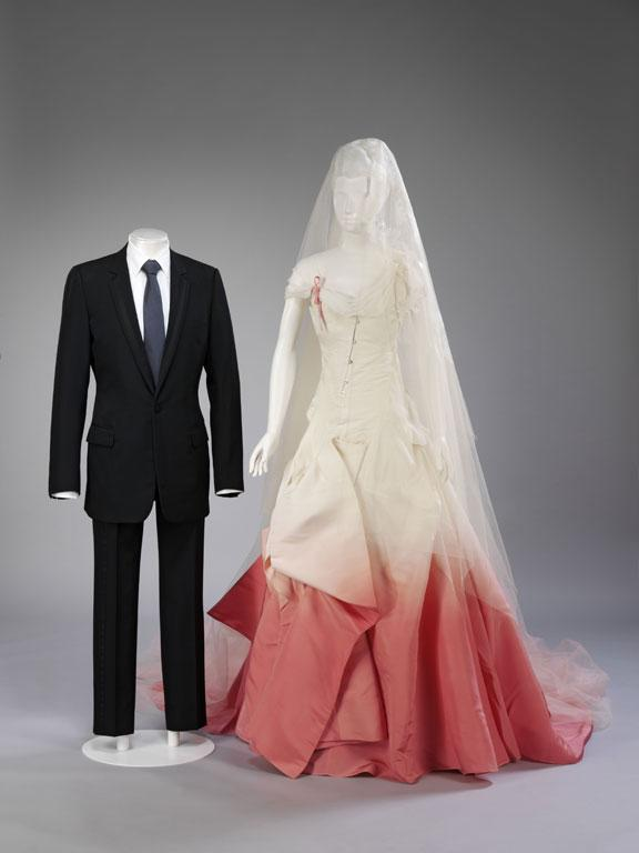 Wool suit, shirt and tie, Dior, Paris, 2002. Silk faille wedding dress and silk net veil decorated with antique lace, John Galliano for Dior, Paris, 2002. Lent and worn by Gavin Rossdale and Gwen Stefani for their wedding in London on 14 September 2002