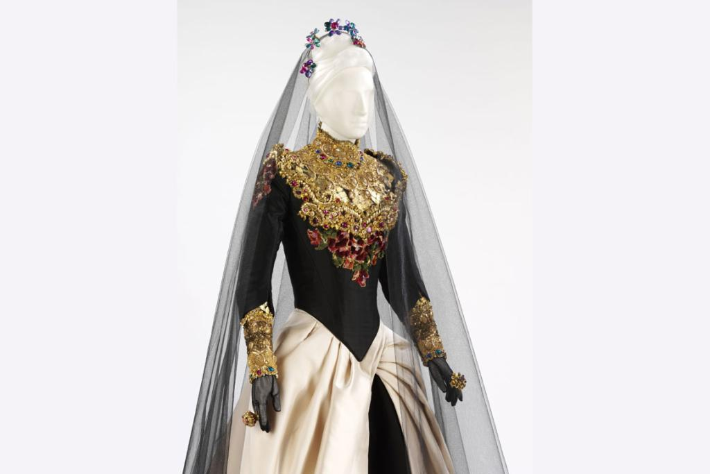 Wedding dress, 'Qui a le droit?', Christian Lacroix Couture, Paris, autumn/winter 1993-4. Silk satin, embellished with gold leaf, foil, beads, paste gems and chenille embroidery. Given by the designer.