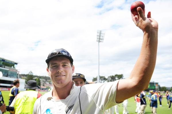 New Zealand bowler Doug Bracewell celebrates after beating Australia in the second cricket test match at Bellerive Oval in Hobart.
