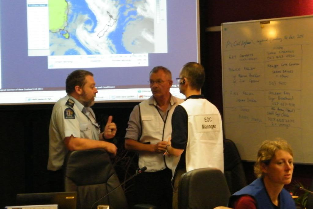 Sergeant Stu Koefoed of Nelson Police, and senior Civil Defence personnel Jim Frater and Roger Ball at tonight's briefing on the flooding situation in Nelson, at the control headquarters in Richmond.