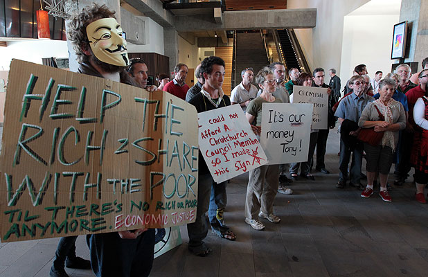 RAGE: Angry Christchurch residents, above, protest against city council chief executive Tony Marryatt's pay rise.