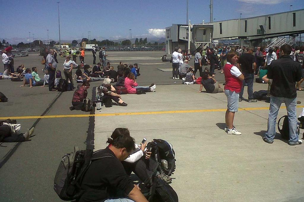 People waiting after being evacuated from Christchurch Airport