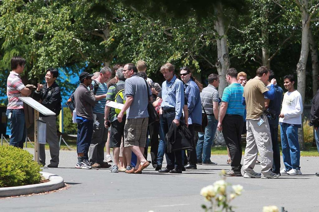 Workers stand around and head home after evacuating premises on Wairakei Rd after a 5.8 quake.