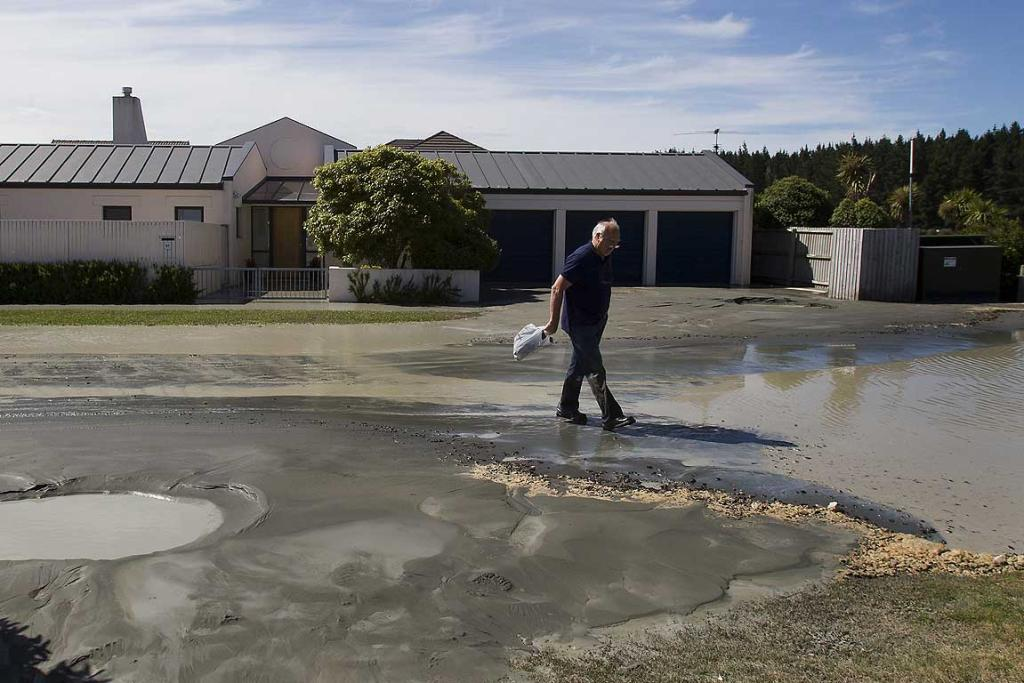 Pita Alexander, a Broadhaven Ave, Parklands, resident, walks through liquefaction.